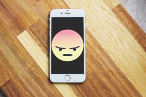 Outrage emoticon angry face on iPhone